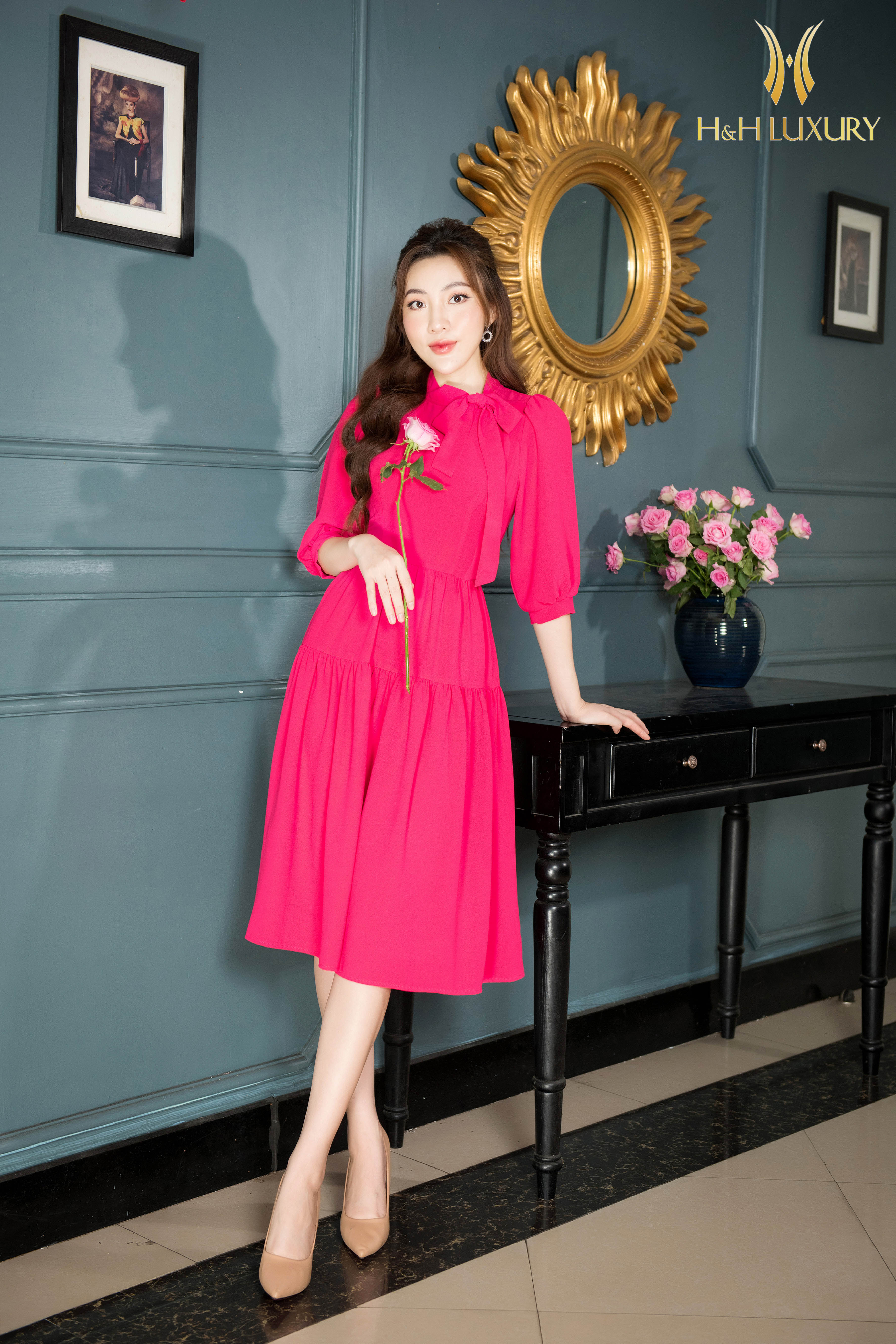 Đầm xòe hồng nơ cổ nhún 3 tầng